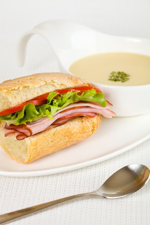 meat soup: Healthy ham sandwich with a vegetable cream soup on the side. Shallow depth of field. Stock Photo