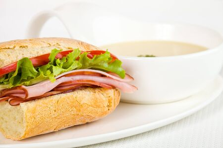 Healthy ham sandwich with a vegetable cream soup on the side. Shallow depth of field. Stockfoto
