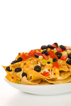 Nachos with vegetable on the top. White background.  Very shallow depth of field.