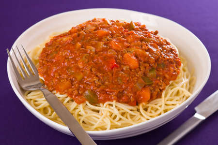 Spaghetti pasta with meat sauce. Shallow depth of field. Фото со стока