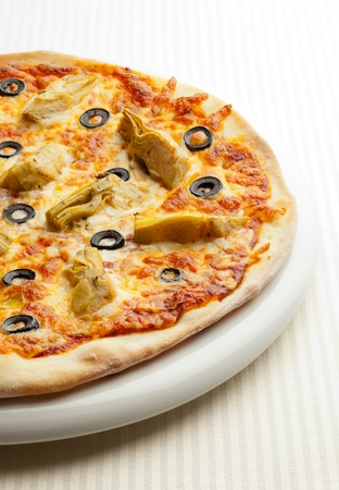 Vegetarian pizza with olive and artichoke