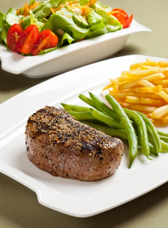 Steak with vegetable and french fries. Reklamní fotografie - 10418977