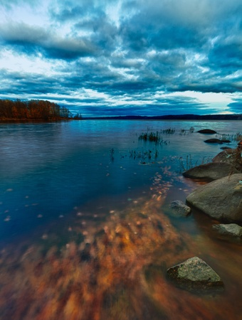 Beautiful scene from canada with orange leafs moving in the water. Hdr and slow shutter speed photography. Stock Photo - 10997622
