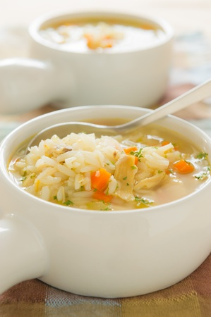 rice noodles: Healthy chicken rice soup with spoon. Shallow depth of field. Stock Photo