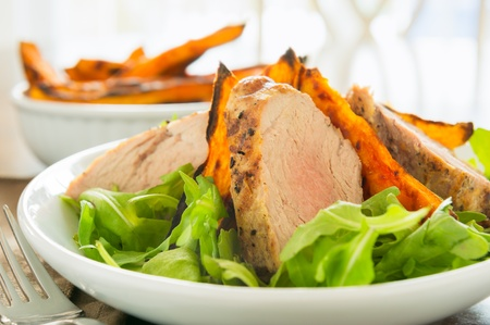 Healthy meal with sliced pork fillet with sweet potato and salad. Shallow depth of field. Stock Photo - 12873974