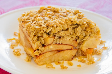 Apple crumble portion in a white plate. Shallow depth of field. Stock Photo - 12874002