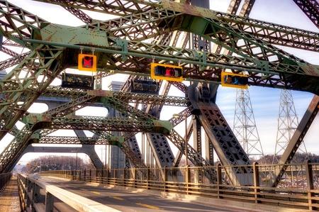 Quebec city's cantilever bridge with moving car.