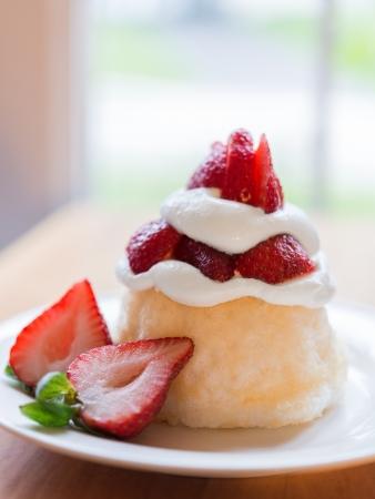 shortcake: Strawberry shortcake on a white plate. Very shallow depth of field.