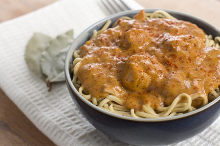 Hungarian Chicken Paprikash - chicken cooked in paprika and cream sauce. Served with egg noodles.