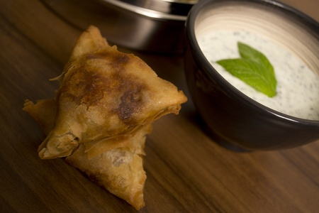 Homemade samosas and mint raita photo