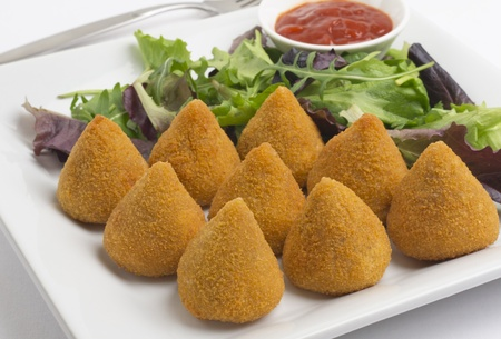 Coxinha de Galinha - Brazilian deep fried chicken snack, popular at local parties. Served with salad and chili sauce.