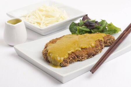 Katsu Kar- Tonkatsu- Japanese breaded deep-fried pork cutlet served with shredded cabbage and curry sauce