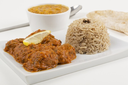 indian meal: Meat madras served with pilau rice, tarka dahl and chapatis.