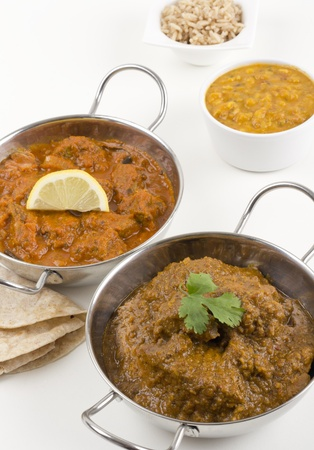 Chicken Xacuti & Meat Madras - Goan chicken chacuti and meat madras served with pilau rice, tarka dahl and chapatis Stock Photo