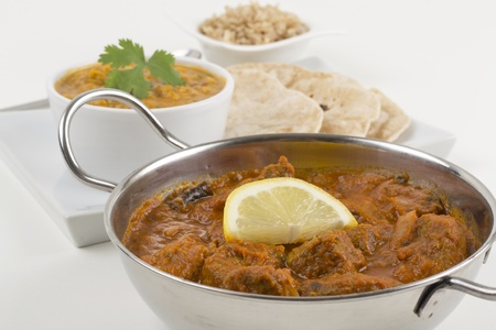 Meat madras served with pilau rice, tarka dahl and chapatis. photo