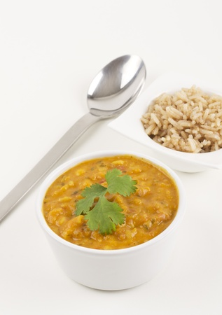 Tarka Dahl and pilau rice on a white background