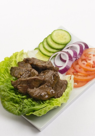 Cambodian (Loc Lac)  Vietnamese (Bo Luc Lac) stir-fried beef salad  Brazilian Filet Aperitivo photo