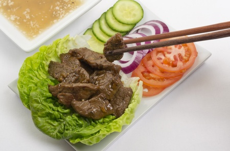 Loc Lac  - Shaking Beef: Cambodian (Loc Lac)  Vietnamese (Bo Luc Lac) stir-fried beef salad. Served with a lime and black pepper dip. photo