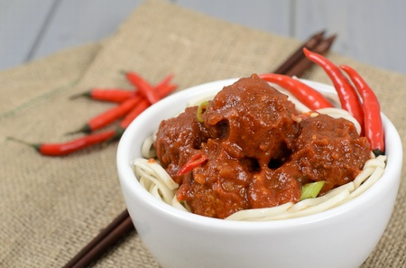Chinese Spicy Meatballs & Noodles - Chinese spicy pork meatballs in fragant tomato sauce served with noodles.