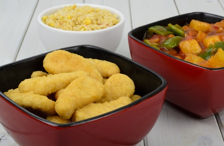 Sweet and Sour Chicken - Chinese fried chicken, sweet and sour sauce with bell peppers and pineapple with a side dish of egg fried rice. photo