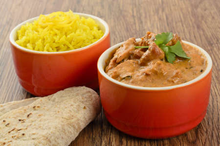 Butter Chicken   Lemon Rice - Indian butter chicken curry and lemon rice served with chapatis   photo