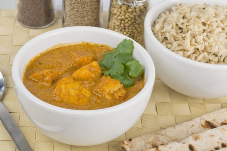 Paneer Makhani or Shahi Paneer (Paneer Butter Masala) - Indian curd cheese curry served with chapatis and pilau rice.  photo