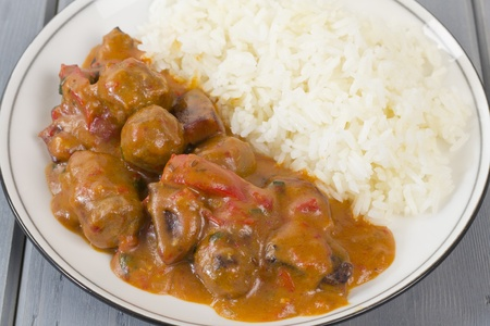 Goulash: Goulash - Hungarian sausage stew served with white rice  Stock Photo