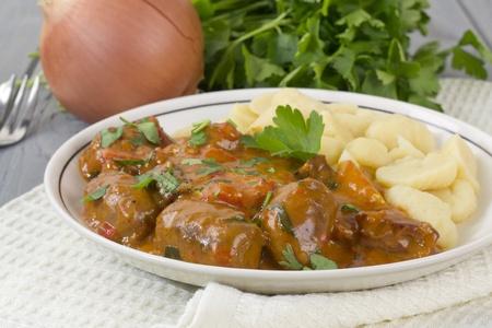 Goulash - Hungarian sausage stew served with homemade nokedli  photo