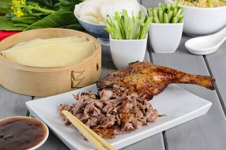 hoisin sauce: Peking Duck - Chinese roast duck served with pancakes, cucumber, spring onions and hoisin plum sauce  Side dish of egg fried rice and prawn crackers