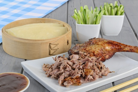 hoisin: Peking Duck - Chinese roast duck served with pancakes, cucumber, spring onions and hoisin plum sauce   Stock Photo