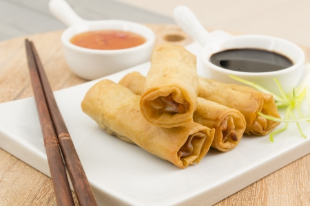 Spring Rolls - Fried vegetable spring rolls served with sweet chili and soy sauce.