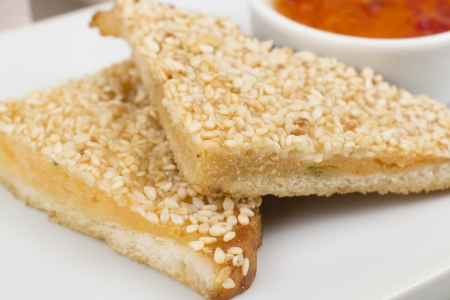 starter: Hatosi (Prawn Toast) - Chinese sesame shrimp toast served with sweet chili sauce. Close up