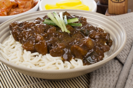 Jajangmyeon - Korean  Chinese pork and vegetables in black bean paste noodles served with danmuji and kimchi.