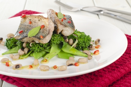 Grilled Mackerel - Pan fried fresh mackerel fillet on a bed of green vegetables and black eyed beans, drizzled with red chilli, lime and olive oil dressing  Stock Photo - 15532091