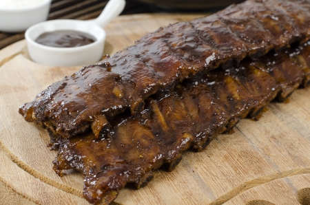 BBQ Ribs - Marinated pork ribs with sour cream and barbeque sauce  Stock Photo