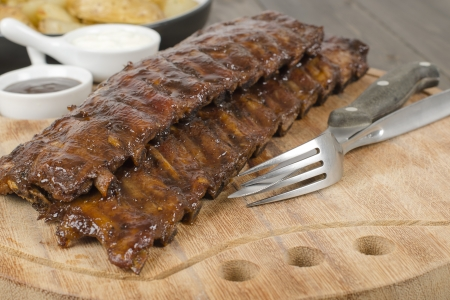 back rub: BBQ Ribs - Marinated pork ribs with sour cream and barbeque sauce  Stock Photo