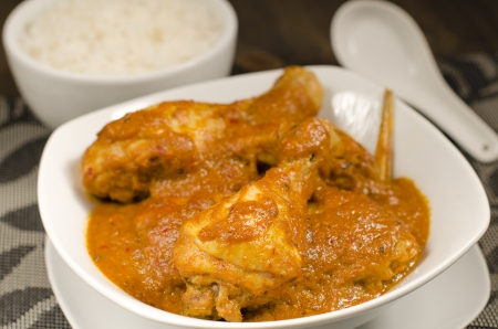 Ayam Kari Kapitan - Malaysian spicy chicken curry with coconut milk served with sticky rice  Traditional Nyonya cuisine  Low key lighting  Close up  Reklamní fotografie