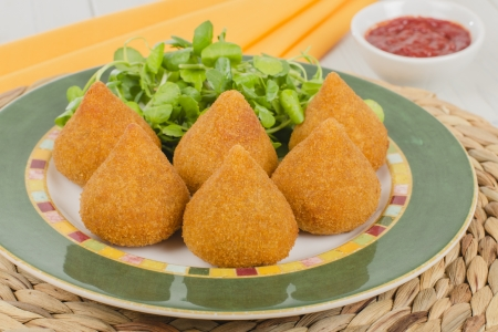 Coxinha de Galinha - Brazilian breaded and deep fried snack filled with shredded chicken  photo