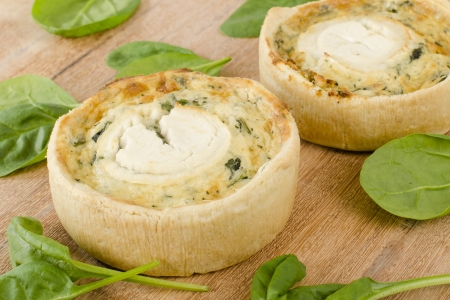 Individual goat s cheese and spinach quiches  Stock Photo