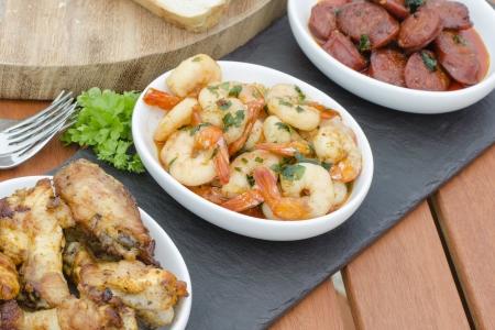 Spanish Tapas - Hot   Spicy Spanish appetisers  gambas pil pil, pollo al ajillo and chorizo al vino