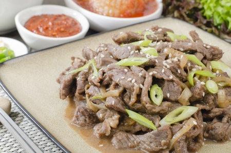 Beef Bulgogi - Korean marinated BBQ beef served with Kimchi and dips