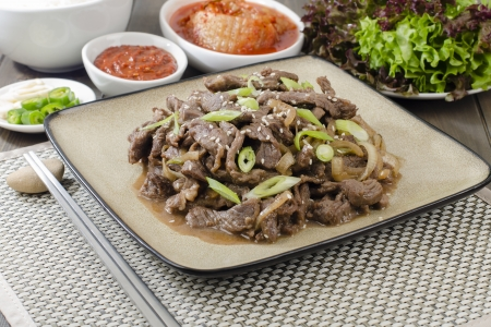 korean traditional: Beef Bulgogi - Korean marinated BBQ beef served with Kimchi and dips
