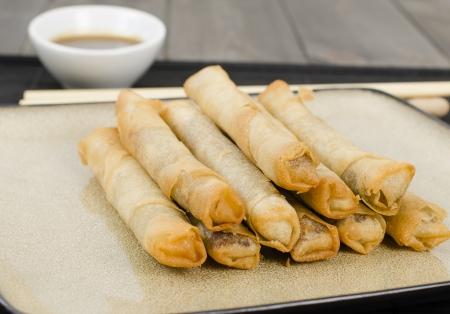 hoisin: Duck Spring Rolls - Thin fried duck spring rolls served with hoisin sauce dip  Dim Sum Stock Photo