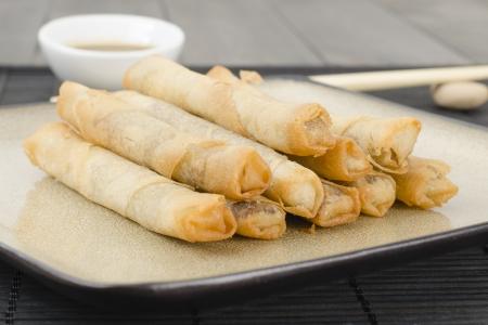 hoisin sauce: Duck Spring Rolls - Thin fried duck spring rolls served with hoisin sauce dip  Dim Sum Stock Photo