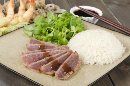 Teriyaki Tuna - Marinated seared tuna served with steamed rice, tempura and dipping sauce  Stock Photo - 15532252