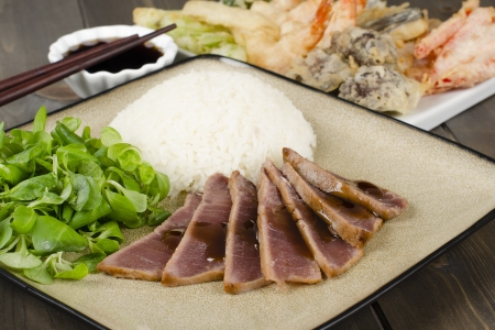 Teriyaki Tuna - Marinated seared tuna served with steamed rice, tempura and dipping sauce  Stock Photo - 15532220