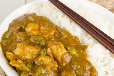 Chinese Chicken Curry with green peas and onions served with steamed rice Stock Photo - 15532215