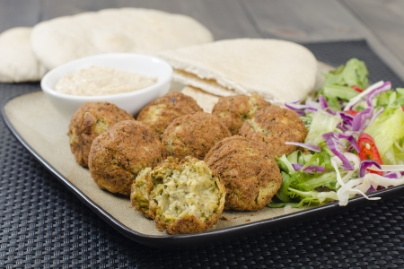 Falafel - Deep fried chickpeas balls served with tahini, salad and pitta bread