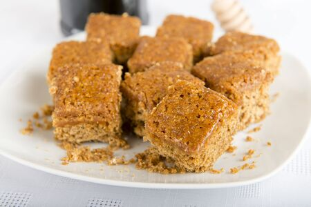 Parkin - Cubed Yorkshire parkin on a white plate  Bonfire feast  photo