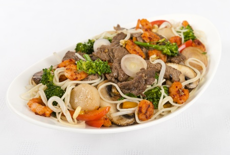 beansprouts: Chow Mein - Chinese Stir-fried noodles with beef, shrimp on a white background